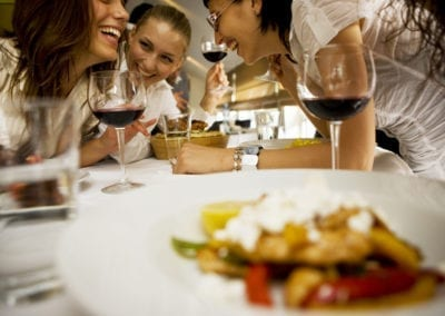 Happy friends at dinning table